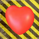 Red heart on grunge hazard stripes. Red heart on old grungy yellow and black hazard stripes background stock photography