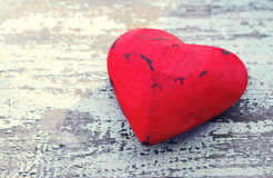 Red heart on a grunge wooden old background. Royalty Free Stock Photo