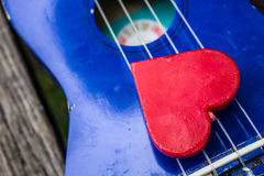 Red heart on guitar. Stock Photography