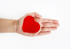 Red heart on hand. Red heart symbol on hand on a white background stock images