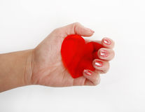 Red heart on hand. Red heart symbol on hand on a white background royalty free stock photo