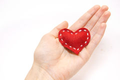 Red heart in hand royalty free stock image