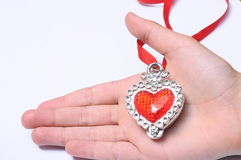 Red heart on hand Stock Photography