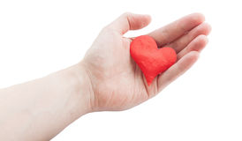 Red heart in hand. Royalty Free Stock Photo