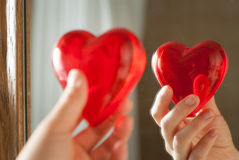 Red heart in hand Stock Images
