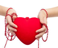 Red heart in the hands stock images
