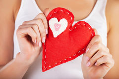 Red heart in hands Royalty Free Stock Image