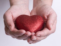 Red heart on hands Stock Photos