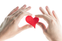 Red heart in hands. Royalty Free Stock Images