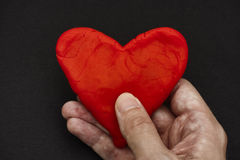 Red heart in hands Stock Images