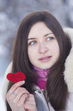 Red heart in hands of pretty girl Stock Image