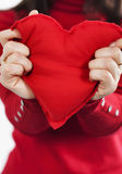 Red heart  in hands Stock Photos