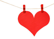 Red heart hang on clothespin isolated on white Royalty Free Stock Image