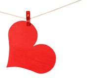 Red heart hang on clothespin isolated on white Royalty Free Stock Photography