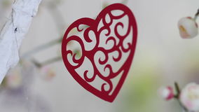 Red heart hanging on bench. Valentine decor. red heart hanging on bench stock video footage
