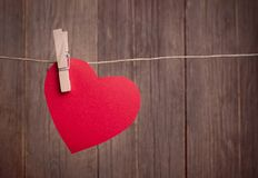 Red heart hanging on the clothesline Royalty Free Stock Photo