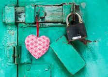 Red heart is hanging on a door with lock Royalty Free Stock Photography