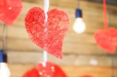 Love heart hanging on rope on a wooden background royalty free stock photo