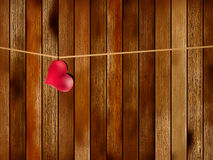 Red heart hanging on old wood. + EPS8. Lovely red heart hanging on the clothesline. On old wood background. + EPS8 vector file Vector Illustration