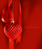 Red heart hanging with ribbon Royalty Free Stock Images