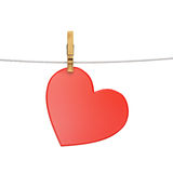 Red heart hanging on rope with clothespins, isolated on white, romantic message. Background Stock Images