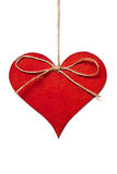 Red heart hanging in thread Stock Image