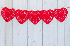 Red heart hanging on white wood for celebration with space. royalty free stock photo