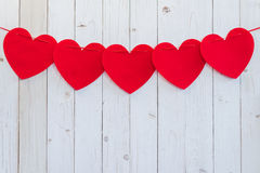 Red heart hanging on white wood for celebration with space. Royalty Free Stock Photos
