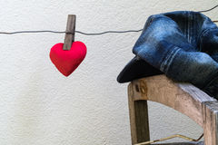 Red heart hanging on a wire Stock Photos