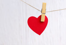 Red heart hanging on wooden background Royalty Free Stock Photo