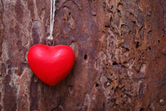 Red heart hanging before wooden board Royalty Free Stock Photo
