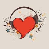 Red heart and headphones Royalty Free Stock Photos