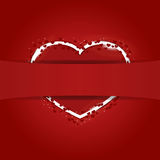Red heart hidden behind the ribbon Stock Photography