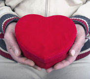 Red heart in his hands Stock Photo