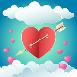 Heart with an arrow. Red heart with holes punched arrow on a blue background with white clouds and pink hearts in a square Royalty Free Stock Images