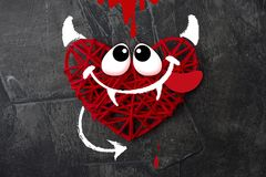 Red heart with a horn and tail of the devil Theme for Valentine`s Day. Wedding, love. 2 Royalty Free Stock Images