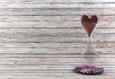Red heart in hourglass. White wood background, 3D render stock photos