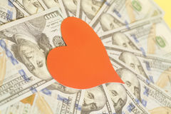 Red heart and hundred dollar bills for background. Red paper heart and hundred dollar bills for background Stock Images