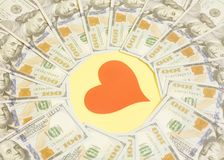 Red heart and hundred dollar bills for background. Red paper heart and hundred dollar bills for background Royalty Free Stock Photo