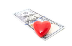 Red heart on hundred dollar note Stock Image