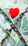 Red heart hundred zloty bills for background and chain Royalty Free Stock Image
