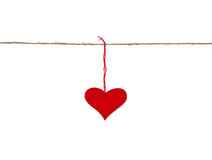 Red heart hung up on the string. Isolated over white Royalty Free Stock Photo