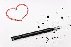 Red heart, ink pen and spatter. Red crayon heart, ink pen and spatter on white paper Royalty Free Stock Images