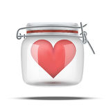 Red heart inside glass jar Stock Photos