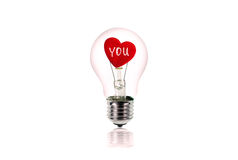 The Red Heart inside of the light bulb isolated on white. Royalty Free Stock Photography