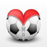 Red heart inside soccer ball Royalty Free Stock Image