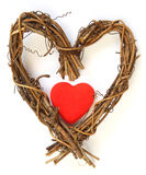 Red heart inside wooden heart Stock Photo