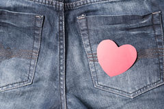 Red heart on jean Stock Photo