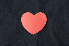 Red heart on jean Stock Images