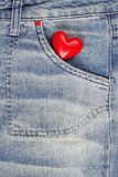 Red heart in jeans trousers pocket Royalty Free Stock Image